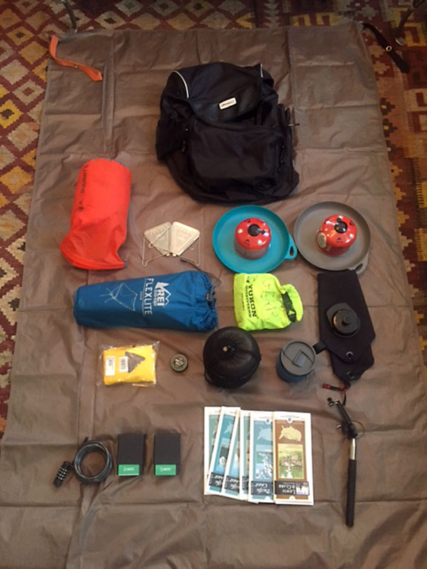 Contents of my left rear pannier. My camping gear with REI Flex Lite Chair and other important items.