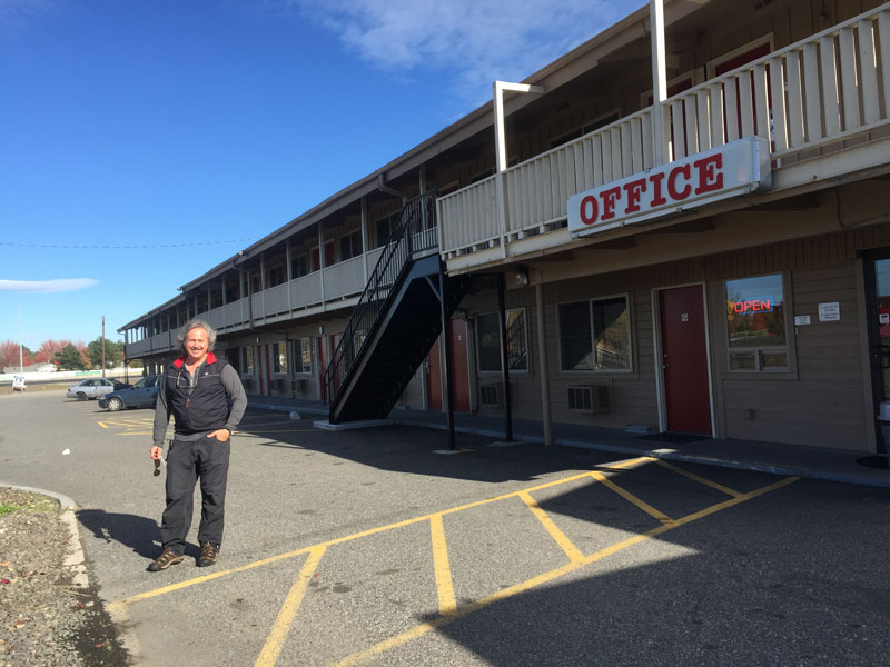 Hugh standing in front of the Econo Lodge in Kennewick, Washington